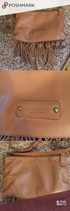 Lucky brand Bailey fringe crossbody shoulder bag Great tan leather that goes with everything. Stylish fringe across bottom. Three compartments; two zippered, one magnetic snap closure. Comes with crossbody strap, plus smaller shoulder strap with about a 7 inch drop. All straps can be removed for use as a clutch. Preloved with signs of gentle wear. Inside is a little dusty but no stains. Leather edges show some wear but overall excellent condition. 9 inches long by 6 inches high by 2 inches…