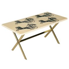 """A Rectangular Coffee Table By Piero Fornasetti  Italy  Circa 1950  A rectangular coffee Table by Piero Fornasetti.  """"Bighe""""  The white ground depicting chariot racers in the Grecian style.  Lithographically printed.  Brass base.  Label to base.  Circa 1950"""