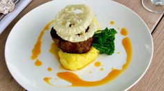 Chargrilled eye fillet wasabi mash broccolini and tempura onion rings with an egg yolk dressing