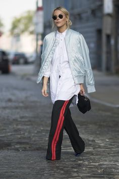 This Universally Flattering Wardrobe Staple Is All Over the Streets at NYFW Button It at the Top, but Let It Breeze Open Down Below