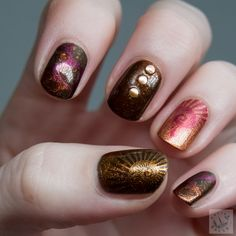http://www.polish-hound.com/2014/10/fall-moyou-stamped-skittle-nails-nail.html