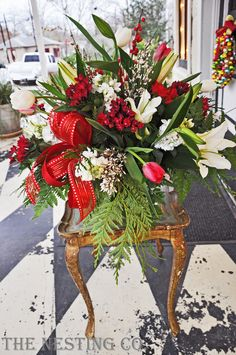 Christmas Centerpiece:  Loved the use of Lillies (spring flower) in this winter arrangement - good balance of color, texture and greenery