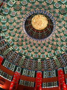 Intricate painted ceiling of a pavilion.  The Ancient Chinese architecture is timberwork, with exquisite applique design and beautiful flower patterns that reflect the high-level of the craftsmen's handicraft and their rich imagination.