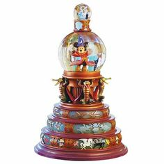 disney snow globes | Mickey globe lights up with a turn of a switch. Spin the topmost globe ...