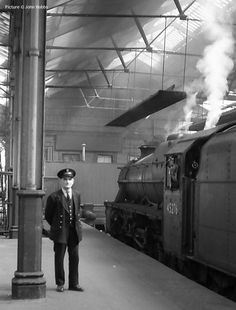 Llandudno in all its former glory as LMS Class 5 4-6-0 45276 stands under the overall roof, at the buffer stops, supervised by a member of the station staff while the driver looks on. The train is 1Z18, on 19 April 1965.