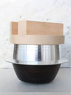 """""""The rice cooker can be used on a standard stove top for those who want to wow their foodie friends. If you are not into cooking, place the lid underneath the pot, as a pedestal, and make this an intriguing succulent pot."""" Peter Gould, assistant director, exhibition design and production"""