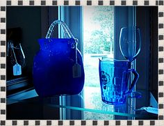 Beautiful Glass Vase in the shape of a purse with clear glass handles.  For the woman who has everything! $25.00