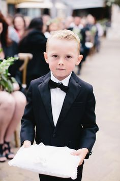 Classic black tux on this cute ring bearer: Photography: Gagewood - gagewoodphoto.com   Read More on SMP: http://www.stylemepretty.com/california-weddings/2016/07/14//