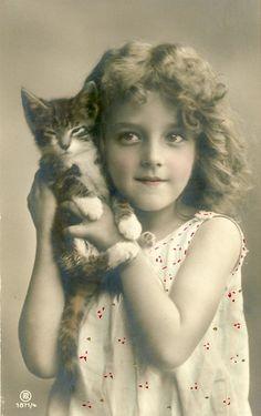 Vintage photo, girl holding kitten