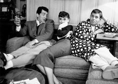 Dean Martin, Audrey Hepburn and Jerry Lewis pal around at the Paramount Studios publicity department, 1953. This was Audrey Hepburn's first trip to Hollywood after making Roman Holiday. Photographs by Bob Willoughby.