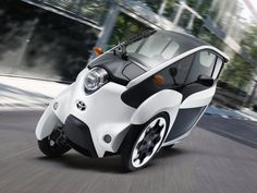 WHEN YOU THINK of Toyota, you probably think of the Prius. Or the Camry, maybe pickup trucks that just won't die. You know, cars.    The i-Road is not a car. It's a funky electric three-wheeled concept the automaker seems to think we'll one day use to zip around cities burning nothing but rubber. It combines the advantages of a motorcycle (nimble, thrifty, easy to park) and of a car (enclosed, controls you're used to, won't topple) in a vehicle that is as fun to drive as it is weird to see.