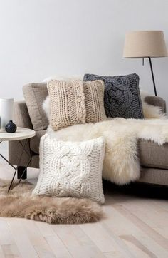 Cozy up your space with the addition of these oversized cable knit pillows.