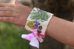 For the girly girls in the bunch, make a nature bracelet using duct tape, ribbon and flowers