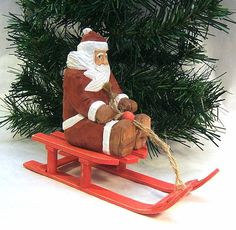 This is a handmade Santa Claus wood carving of Santa on a sled. It is carved from basswood and painted with non-toxic acrylic paint. Santa is just over 4.25 inches tall, not counting the sled. This is carved by hand using knives and gouges. This would be perfect for a Christmas present or gift or for decorating your own home. Background greenery not included. TO SEE ALLOF THE SANTAS AND SNOWMEN THAT I HAVE AVAILABLE CLICK: https://www.etsy.com/your/shops/ClaudesWoodca...
