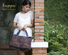 CAMILLA ENDE SHOULDER BAG  by: Kuppu Batik & Tenun  3.450.000,00  A unique and beautiful natural-dye antique tenun ikat (hand woven) from Ende, Flores island, East Nusatenggara, Indonesia Combined with navy blue Italian genuine cow leather 38x29x12cm (LxHxW)  Eco-suede fabric lining Enclosed zip closure middle pocket Top zip closure With long straps With Kuppu handbag tag Weight: 1.0 kg  www.kuppubatiktenun.com  More Info Laura 08119103668 Pin BB 751E6162 Line ID kuppubatiktenun