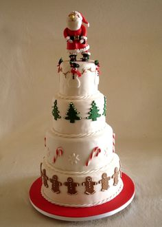Christmas Cake ...love the borders around the sides! Although I think it would look better with just Santa legs sticking out on the top layer! (Probably just me!lol)