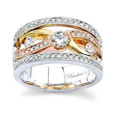 A Unique Tri Color Gold Diamond Wedding Band Yellow And Rose Bands Cross In The Center Are Graced By Channel Set Round Pave Pink