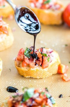 Classic Onion Tomato Bruschetta with Balsamic Glaze is a great appetizer for just about any occasion! Find the recipe on www.cookwithmanali.com