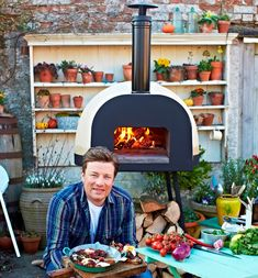 Outdoor Kitchen Ideas - what pizza topping would you have? or would you venture into roasts, puddings, stews to handmade breads? all is possible with these fabulous wood fired outdoor ovens!