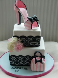 - Shoe and handbag cake. The black lace is just real lace, the shoe and handbag are made from modelling/flower paste. Had real trouble with this shoe, normally for my shoes I use just flower paste so it sets really hard but this one kept wilting, I then realized it was due to moisture in the air from my washing drying! All fixed in the end. :)