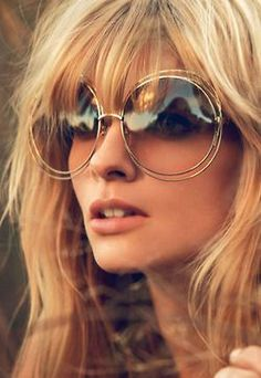 Big round gold metal framed seventies inspired sunglasses