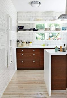 dark wood cabinets working like a boss in a bright white kitchen