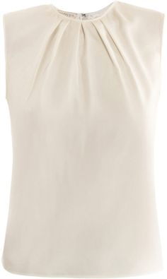 cream silk sleeveless blouse, round-neck with a gathered neckline detail and a zipped centre-back fastening. 100% silk. Dry clean. Country of origin: Italy.