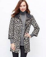 "Cheetah Coat - Strikingly spotted to add animal intrigue to any ensemble, this cheetah print style leads the pack. Layer over a cozy sweater or pair it with long gloves for a sleek evening look. Stand collar with faux leather underneath. 3/4 sleeves. Hidden button front. Vertical on-seam welt pockets. Lined. 31 1/2"" long."