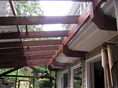 A way to attach a pergola to our house w/out taking away the gutters a. A way to attach a pergola to our house w/out taking away the gutters and not using extra vertical supports!