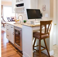 Small bar and stool for laptop in kitchen