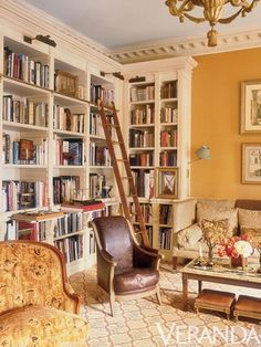 Rich, golden walls, and hefty mouldings and built-ins in this cheery yet tres elegant library by Charlotte Moss.