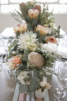 Blushing Bride protea, spider mums, lisianthus, roses, seeded and regular euc, stock. Stunning.