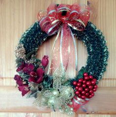 Green Christmas Hand-Knitted with Lace  Wreath and decorated with Silk Flowers, artificial berries & wired ribbon.