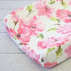 Make your baby changing table pretty with this cute pink petunia floral changing pad cover. Coordinates with the designer Pink Petunia baby bedding or for other pink themed or white themed nursery dec