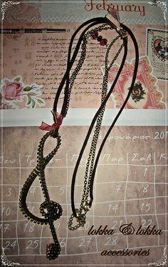 zipper necklace/ treble clef