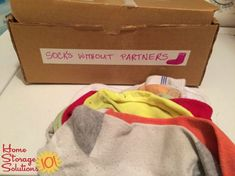 Socks without partners box for holding unmated socks until find the pair {featured on #HomeStorageSolutions101}
