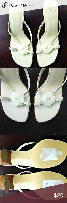 Anne Klein Size 7 1/2M High Heels Anne Klein Size 7 1/2M Ivory/Brown High Heels Slip On Sandals Leather Upper  For your consideration is Anne Klein high hills slip on sandals. It features flower design made of mother of pearl plastic plates and beads.  These sandals never been worn and still have tag. But these shoes were tried. One of the sandals has couple of scratches near toes. Please, look at the picture for more details. Though on the picture these scratches look really deep but they…