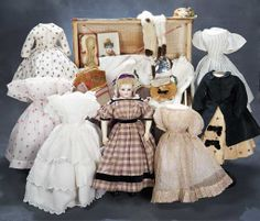 Porcelain Poupee  — 14''Early Petite French with Extensive Trousseau and Accessories in Trunk, 1858    (634x1024)