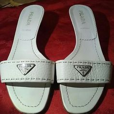 PRADA authentic white slides Preowned some sign of wearing bank on heels Prada Shoes Sandals