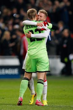 Jasper Cillessen and Viktor Fischer of Ajax celebrate victory after the UEFA Champions League Group H match between Ajax Amsterdam and FC Barcelona at Amsterdam Arena on November 26, 2013 in Amsterdam, Netherlands.