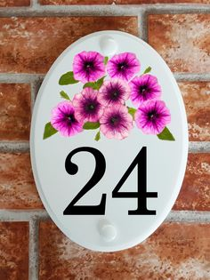 A range of pottery style house plaques feature prints of original artwork from our own sign artists. Hand cast in cultured marble these number plates are weatherproof outdoors. House Plaques, House Number Plaque, House Numbers, Petunias, Floral Motif, Wine Glass, Original Artwork, Pottery, Tableware