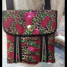 "Betsy Johnson Cheetah & Roses Bag Crazy nice Betsey Johnson crossover in beautiful vibrant colors of red, pink, green, mixed with ivory and black accents.  This Cheetah Blossom bag has gold  tone zippers, front snap closure, one inside zipper pocket, and a 1 1/4"" wide nylon adjustable shoulder strap with Betsey Johnson name on it. Pleated in the front center. All lined. Betsey Johnson Bags Crossbody Bags"