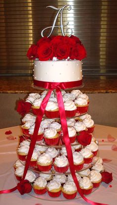 Wedding Cupcake Tower, white with red roses on top and complete with a bow! By: Sweet Soirées