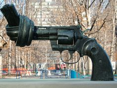 This is a sculpture outside the UN headquarters in New York. Created by the Swedish artist Carl Fredrik Reutersward as a tribute to John Lennon.