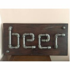 These wall signs are our favorite! Beer & Bath   plumbing-pipe-decor-beer-sign-15.jpg