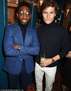 Dashing: Tinie Tempah put on a stylish display in a chambray blazer as he posed for pictures with model and Pixie Lott's beau, Oliver Cheshire