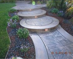 Curved, stamped concrete steps with recessed lighting Concrete Patios, Concrete Front Steps, Stamped Concrete Walkway, Stained Concrete Driveway, Cement Steps, Concrete Garden, Front Yard Walkway, Front Porch Steps, Front Yard Landscaping