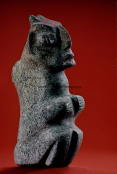 seated carved stone figurine with traces of paint, Tenochtitlan, Templo Mayor, Aztec, Mexico, Mexico City, Great Temple of the Aztecs, .