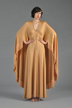 Golden Draped Maxi Gown with Fringed Cape   BUSTOWN MODERN