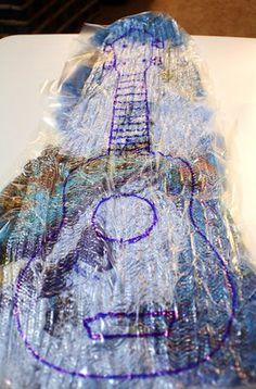 Fiber Art using Dissolve 4x Water Soluble Stabilizer {Outlining the Ukulele}